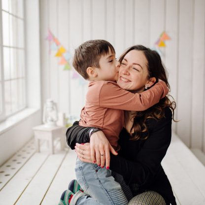 mother-her-son-are-posing-studio-wearing-casual-clothes_1328-2348